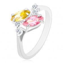 Ring in silberner Farbe, zwei glänzende rosa und gelbe Zirkoniakörner