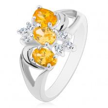 Ring mit geteilter Ringschiene, gelbe Zirkoniaovale, klare Zirkone