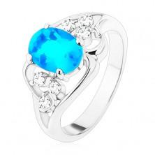 Silberfarbener Ring, großer blauer ovaler Zirkon, asymmetrische Linien