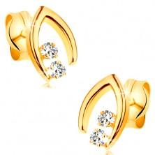 Diamantenohrringe in 14K Gelbgold - zwei Brillanten in spitzem Hufeisen