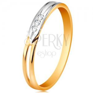Ring aus 14K Gold, zweifarbige Ringschiene mit drei klaren Zirkoniasteinen
