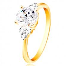 Ring aus 14K Gold - großer klarer Zirkon in der Mitte, je drei Zirkone an den Seiten