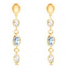 Ohrringe aus 14K Gelbgold - hängende Ovale, Zirkone in hellblauer und klarer Farbe