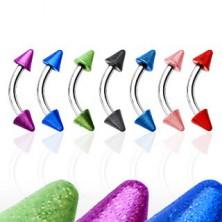 Augenbrauenpiercing mit zwei farbigen Pins
